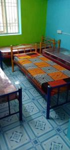 Bedroom Image of Chennai Sr Mens Hostel in Semmancheri