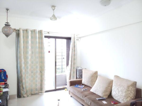 Living Room Image of 650 Sq.ft 1 BHK Apartment for rent in Malad West for 26000