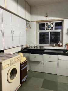 Kitchen Image of Girl's PG in Dahisar East