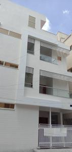 Gallery Cover Image of 5600 Sq.ft 10 BHK Independent House for rent in Koramangala for 600000