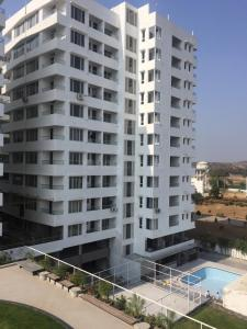 Gallery Cover Image of 900 Sq.ft 2 BHK Apartment for buy in DCNPL Hills Vistaa, Super Corridor for 4537100