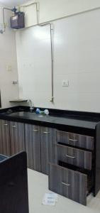 Gallery Cover Image of 690 Sq.ft 1 BHK Apartment for rent in Sheth Vasant Fiona, Thane West for 21200