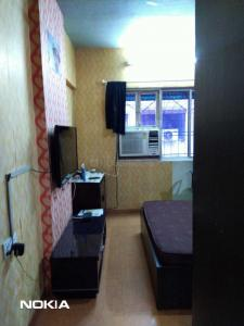Gallery Cover Image of 620 Sq.ft 1 BHK Apartment for rent in Malad West for 32000