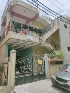 Gallery Cover Image of 1200 Sq.ft 2 BHK Independent House for buy in Koramangala for 18000000