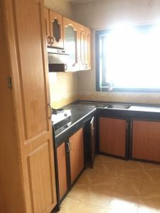 Kitchen Image of Oxotel Paying Guest in Bhandup West