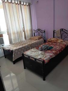 Bedroom Image of Balaji Paying Guest in Powai