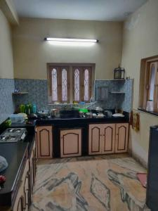 Kitchen Image of Golani PG in Gariahat