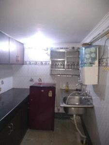 Kitchen Image of Sai Bhawan PG in Govindpuri