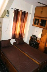 Bedroom Image of Hitanshi PG in Borivali East