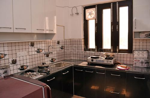 सेक्टर 48 में कौशिक हाउस विपुल वर्ल्ड के किचन की तस्वीर