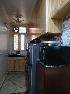 Kitchen Image of Khandelwal PG in Sultanpur