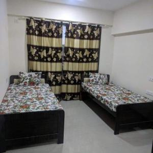 Bedroom Image of The Habitat Mumbai in Kandivali West