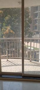 Gallery Cover Image of 600 Sq.ft 1 BHK Apartment for buy in Rajendra Dolphin Tower, Malad West for 9000000