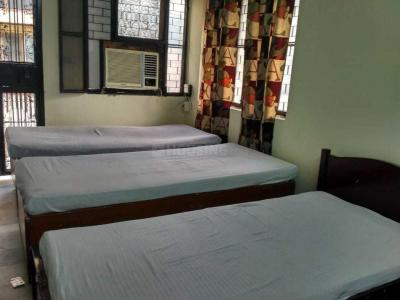 Bedroom Image of Nisha PG in Janakpuri