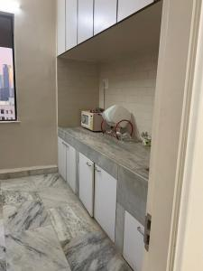 Kitchen Image of Ranjeet Property PG in Tardeo