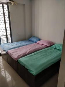 Bedroom Image of Aarjav PG Homes in Navrangpura