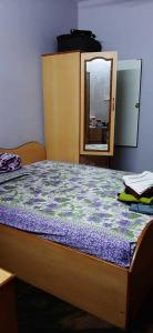Bedroom Image of Basera Punjabi PG in Kumaraswamy Layout