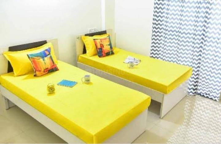 गोरेगांव ईस्ट में गर्ल्स पीजी के बेडरूम की तस्वीर
