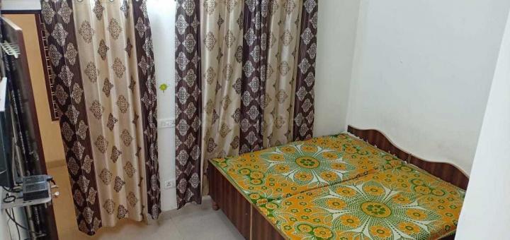 सेक्टर 21 में अमृत रेसिडेंसी पीजी के बेडरूम की तस्वीर
