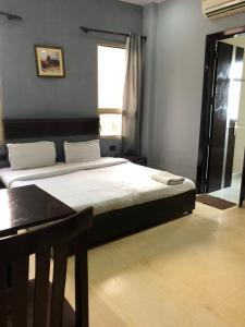 Bedroom Image of Sai Home PG in Sector 31