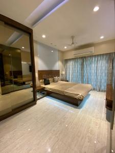 Gallery Cover Image of 550 Sq.ft 1 BHK Apartment for buy in SMGK Urbana Heights, Jogeshwari West for 9900000