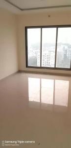 Gallery Cover Image of 650 Sq.ft 1 BHK Apartment for buy in Raviraj Tarang, Dahisar West for 10500000