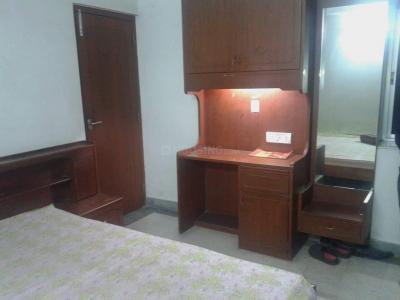 भोवनिपोरे में जैन पीजी के बेडरूम की तस्वीर