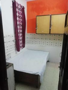 Bedroom Image of Prem PG Accommodation in Govindpuri