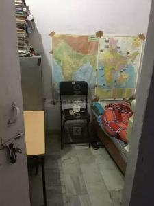 Bedroom Image of Om PG in Mukherjee Nagar