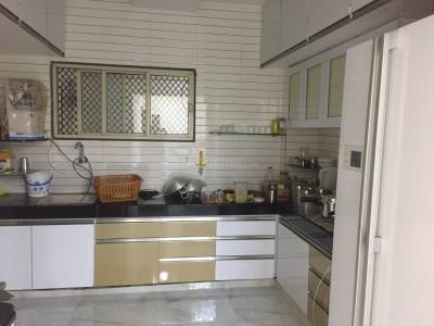 Kitchen Image of Neepa Accomodation in Prahlad Nagar