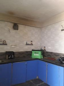 Kitchen Image of Dhanushi PG in Nagavara