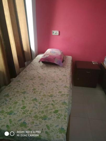 सेक्टर 15 रोहिणी में रीटा पीजी के बेडरूम की तस्वीर
