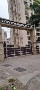 Gallery Cover Image of 800 Sq.ft 2 BHK Apartment for buy in Raunak Unnathi Woods Phase 1 and 2, Kasarvadavali, Thane West for 8100000