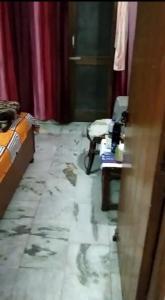 Bedroom Image of Praveen PG in Govindpuri