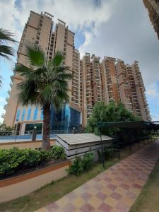 Gallery Cover Image of 1095 Sq.ft 2 BHK Apartment for buy in Savfab Jasmine Grove, Wave City for 3831405