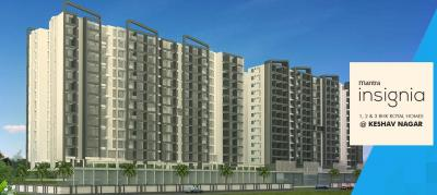 Gallery Cover Image of 1240 Sq.ft 3 BHK Apartment for buy in Mantra Insignia, Mundhwa for 8500000